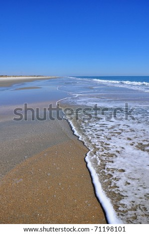 Beach scene with surf - stock photo