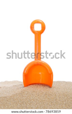 beach shovel stuck in the sand on a white background - stock photo