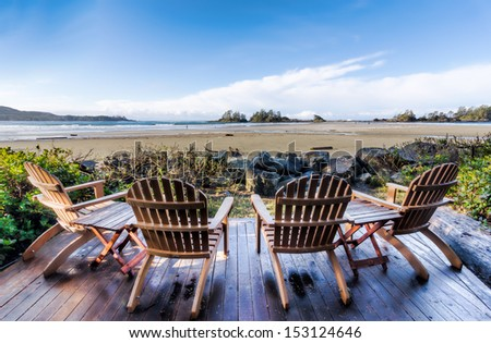Beach side deck chairs - stock photo