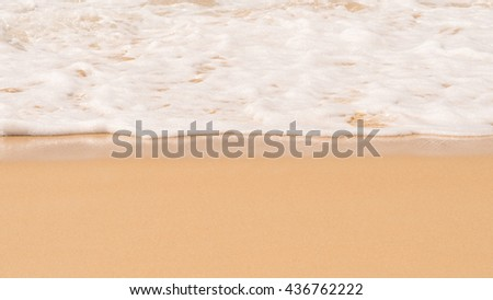 Beach. Soft white wave foam of the sea on sandy beach at Phuket, Thailand. Summer time at sea beach concept. Copy space for some text. - stock photo