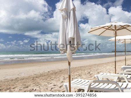 Beach - Sunshade on the beach in a beautiful sunny day - stock photo