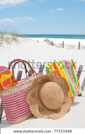 beach supplies on sand dune - stock photo