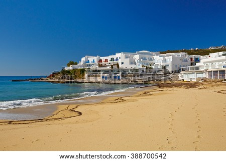 Beach surrounded by hotels on Mykonos island, Greece. - stock photo
