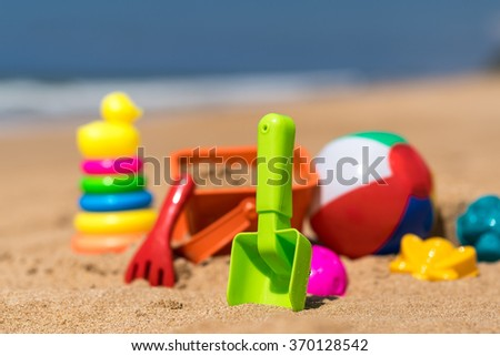 Beach toys in the sand at the beach - stock photo