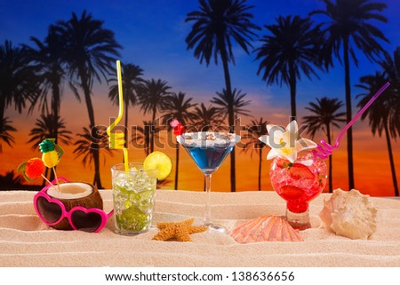 beach tropical cocktails on white sand mojito blue hawaii on sunset palm trees - stock photo