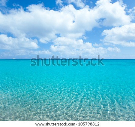 beach tropical with white sand and turquoise water under blue sky - stock photo