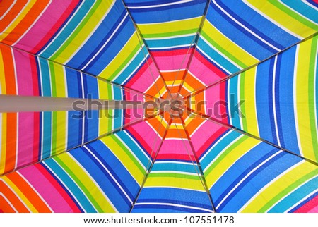 Beach umbrella and blue sky on a summer day