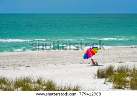 stock-photo-beach-umbrella-and-chair-on-