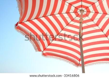 Beach Umbrella and Sky - stock photo