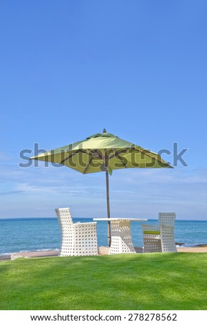 Beach Umbrella And Sunbath Seats In A Tropical Beach Hotel That Located In Costal Area Negambo, Sri Lanka - stock photo