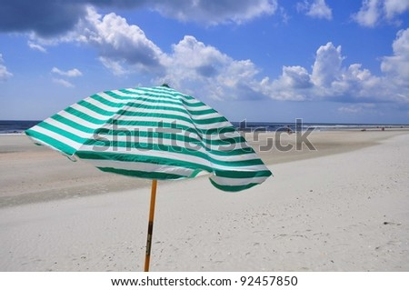 Beach umbrella at the sea shore - stock photo