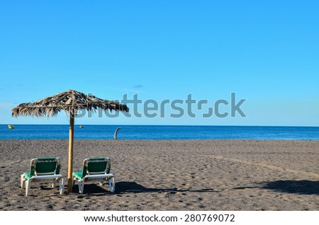Beach Umbrella in Tenerife Canary Islands Spain Europe - stock photo