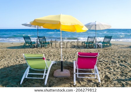Beach Umbrellas and Chairs in Limassol, Cyprus - stock photo