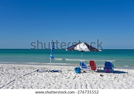 Beach Umbrellas and Chairs on the Beach - stock photo