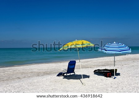 Beach Umbrellas and Chairs on the white sand Beach - stock photo