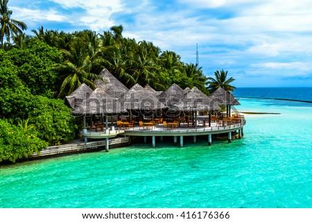 beach villa in maldives near blue lagoon - stock photo
