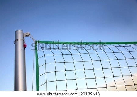 Beach volley net in late summer sunset - stock photo