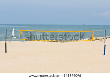 Beach volley net on the beach - stock photo