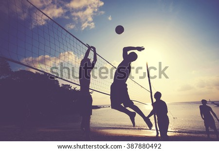 Beach Volleyball at Sunset Enjoyment Concept - stock photo