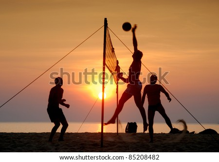 Beach volleyball Is a popular sport that is played on the beach and playground sand - stock photo