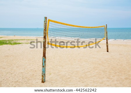 Beach Volleyball net on sandy beach with sea,color tone - stock photo