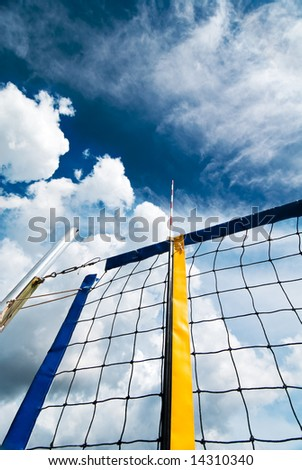 Beach volleyball net over fantastic cloudy sky - stock photo