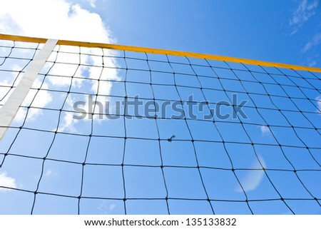 Beach volleyball net with a blue sky