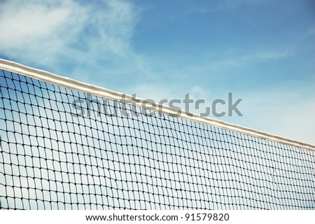 beach volleyball net with blue sky background - stock photo