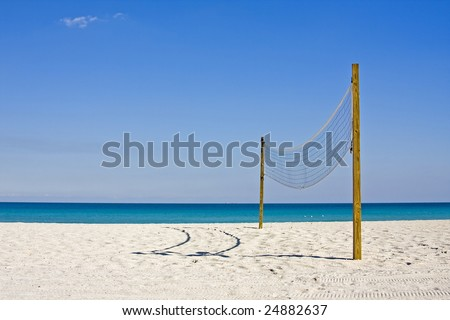 beach volleyball on a sunny summer day with blue sky and ocean background - stock photo