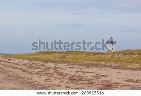 Beach walk to a lighthouse at Cape Cod - stock photo