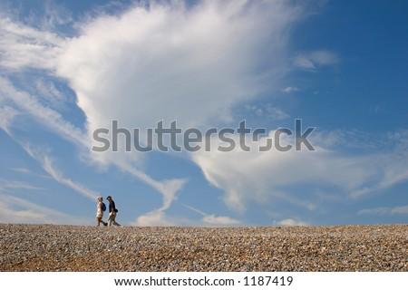 beach walkers - stock photo