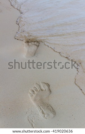 beach, wave and footsteps. - stock photo