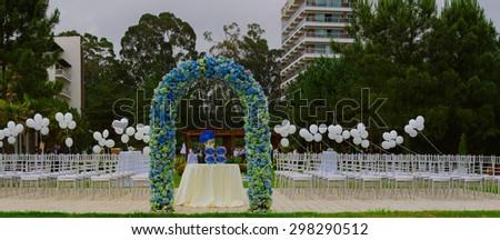 beach wedding set up, outdoor wedding reception, wedding arch - stock photo