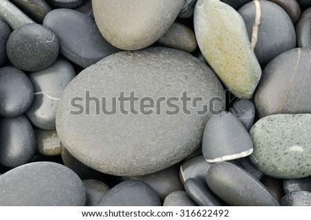Beach wet pebbles background   - stock photo