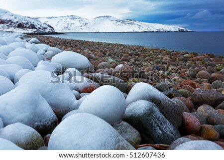 Beach with big round stones on the coast of the Barents Sea, Arctic