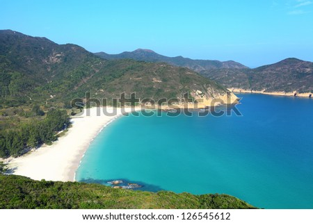 beach with blue sky and sea - stock photo