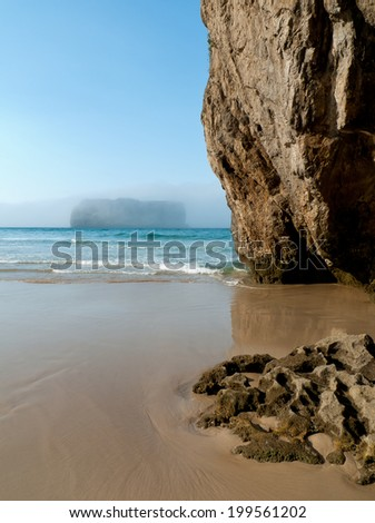 beach with cliff and exotic beauty   - stock photo