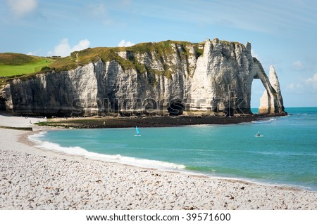 Beach with cliff Falaise d'Aval. Normandy, Cote d'Albatre, France. - stock photo
