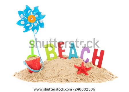 Beach with toys, starfish and sand isolated over white background - stock photo