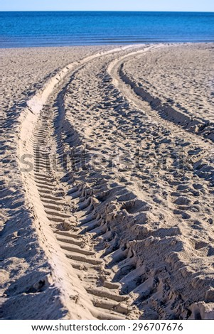 Beach with tracks - stock photo