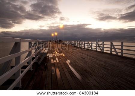 Beach wood bridge - stock photo