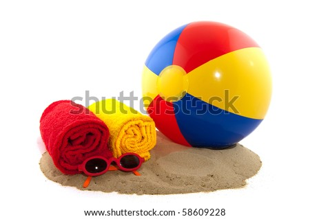 Beachball with rolled towels in red and yellow - stock photo