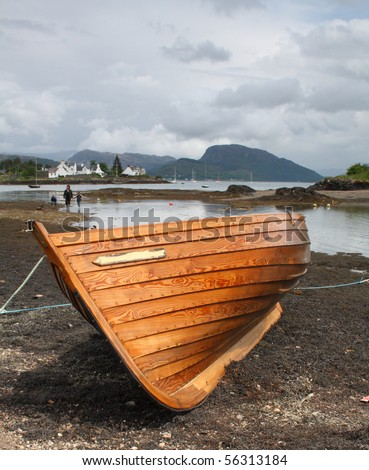 Beached boat, on the shores of Loch Carron, in the village of Plockton, Scotland - stock photo
