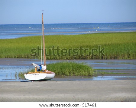 Beached sailboat at low tide, Cape Cod - stock photo