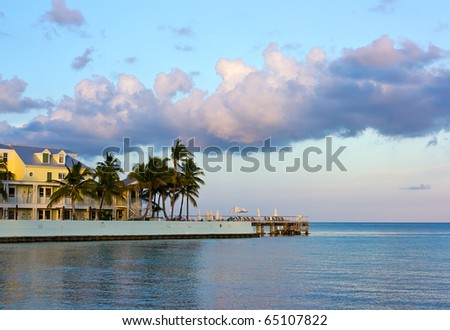 beachfront hotel under beautiful clouds in Key West at sunset - stock photo