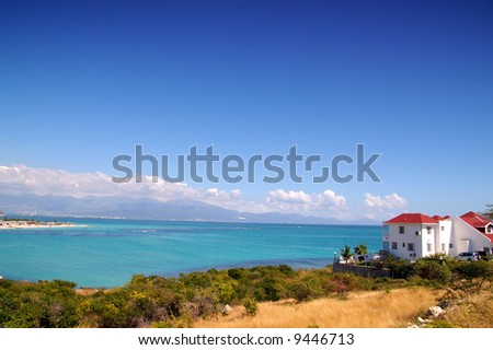 beachhouse by the sea - stock photo