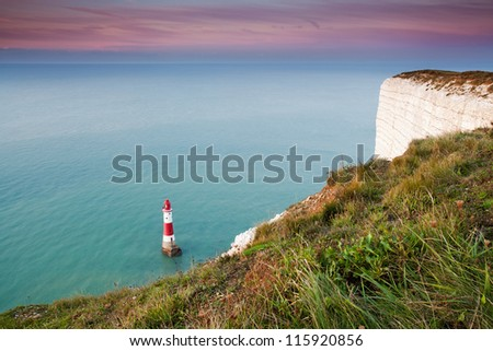 Beachy Head lighthouse at sunrise . View from white cliffs' edge . Eastbourne, East Sussex, UK - stock photo