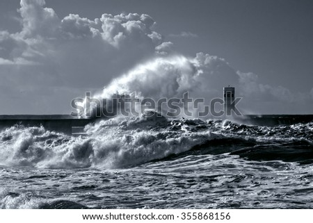Beacon and south pier of Douro river mouth under heavy storm with big waves. Used infrared filter. Toned blue. - stock photo