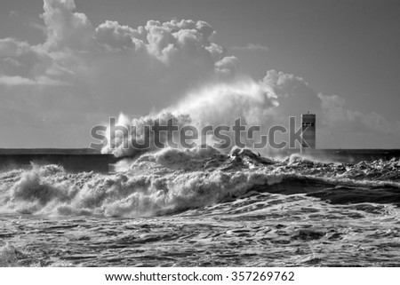 Beacon and south pier of Douro river mouth under heavy storm with big waves. Used infrared filter
