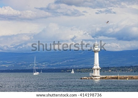 Beacon and the sailing yacht on the lake Leman in Geneva - stock photo